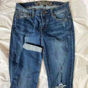 Ripped dark washed skinny jeans